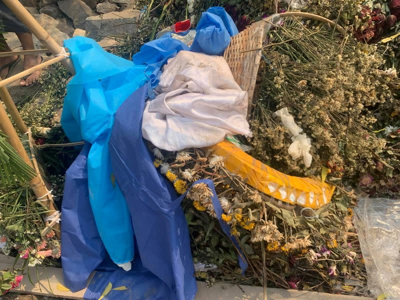 Objects lie around the grave of a 19-year-old protester, Kyal Sin, in Mandalay