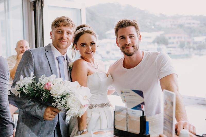 Bride and groom pose with Liam Hemsworth at Currumbin Beach Vikings Surf Life Saving Club