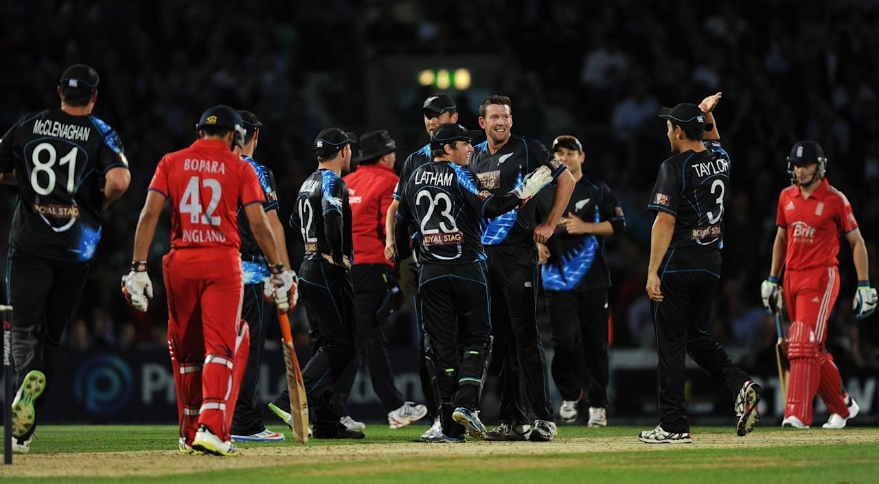 New Zealand players celebrate as England's Jos Buttler (right) is run out during the Natwest International Twenty20 match at the Kia Oval, London.