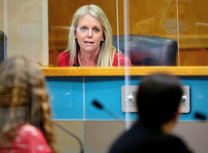 Palm Beach County commissioner Melissa McKinlay quizzes Palm Beach County Health Director Dr. Alina Alonso about the comparison of vaccines and monoclonal antibody treatments during the commission meeting in West Palm Beach Tuesday, Sept. 14, 2021.