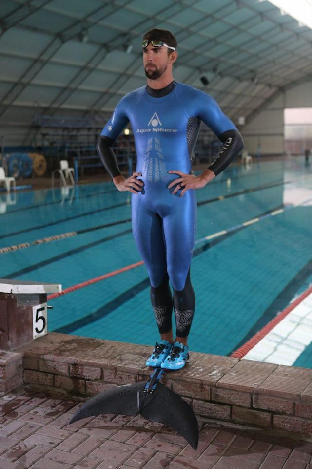 Michael Phelps wearing a Lunocet swim fin and Phantom Suit to give him a competitive edge against a shark. (Photo: Discovery)