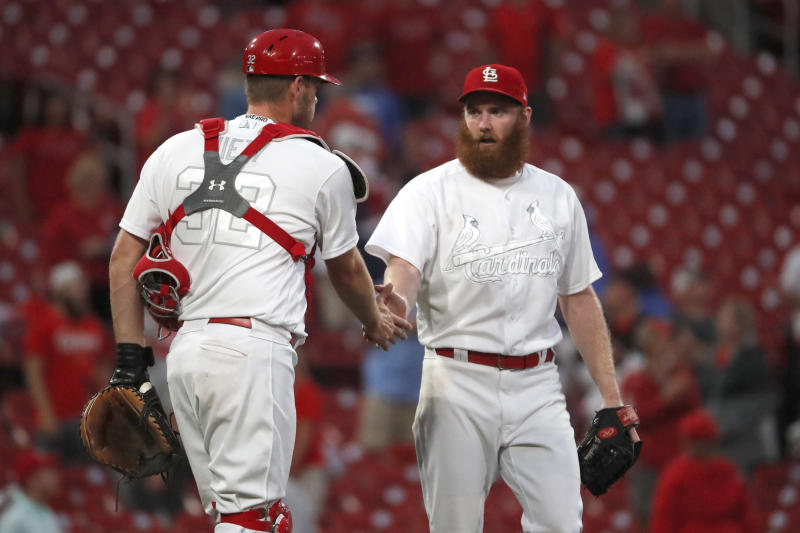 St. Louis Cardinals relief pitcher John Brebbia, right, and catcher Matt Wieters celebrate an 11-4 victory over the Colorado Rockies in a baseball game Sunday, Aug. 25, 2019, in St. Louis. (AP Photo/Jeff Roberson)