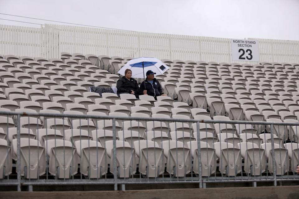 Sparsely populated stands as A-League fans brave the rain and the ongoing threat of the coronavirus (COVID-19) outbreak during the round 23 A-League match between Sydney FC and the Perth Glory at Netstrata Jubilee Stadium in Sydney, Australia.