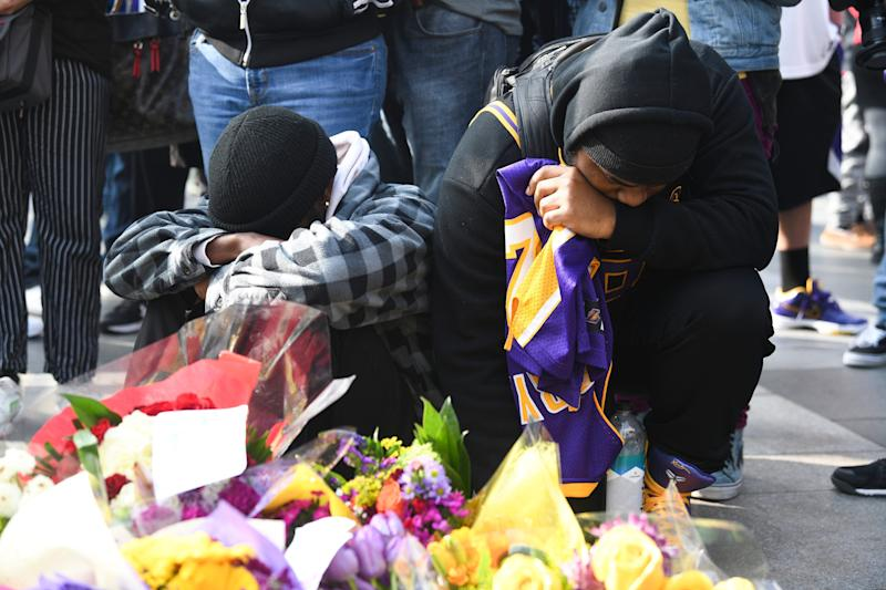 Fans Mourn the loss of NBA legend Kobe Bryant outside of the Staples Center in Los Angeles.