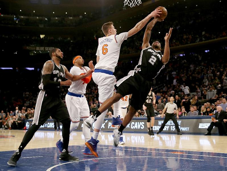 Kristaps Porzingis of the New York Knicks blocks a shot by Kawhi Leonard of the San Antonio Spurs in the fourth quarter, at Madison Square Garden in New York, on February 12, 2017 (AFP Photo/ELSA)