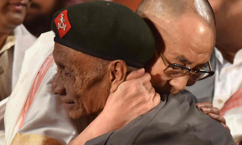 The Dalai Lama embraces Naren Chandra Das