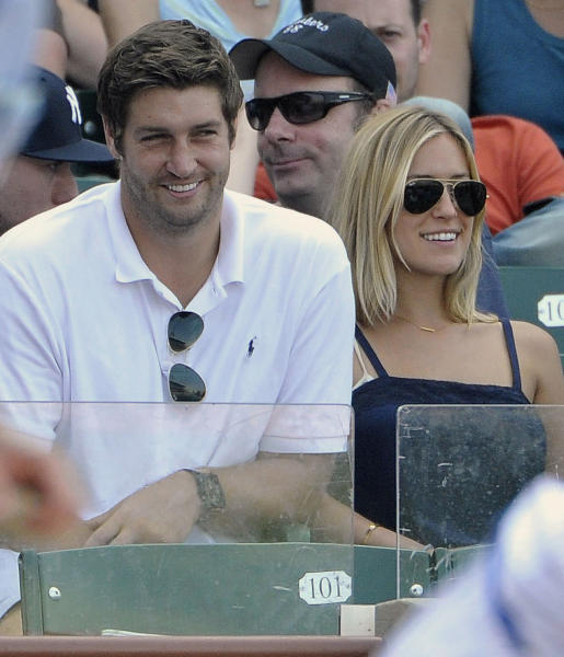 """FILE - In this July 2, 2011, file photo, Chicago Bears quarterback Jay Cutler, left, and Kristin Cavallari watch the Chicago Cubs play the Chicago White Sox during an interleague baseball game in Chicago. Cutler says marriage has done one thing for him: the Bears quarterback feels much older. """"I feel old, I really do,"""" Cutler said Tuesday, June 11, 2013, in confirming that he and Cavallari had recently married. """"It feels good."""" (AP Photo/Brian Kersey, File)"""