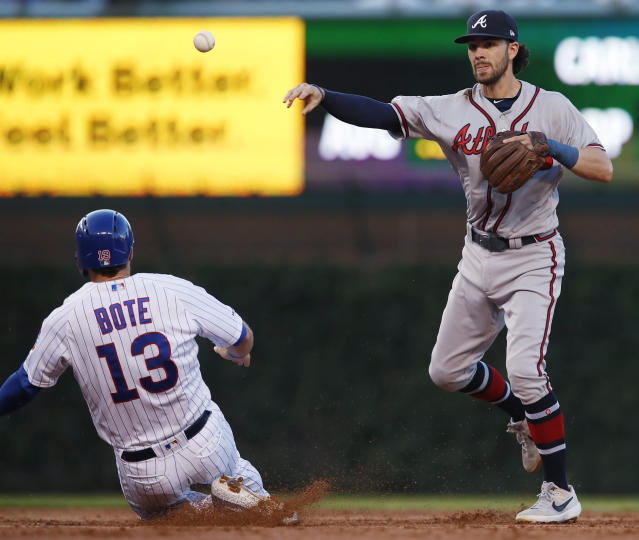 Chicago Cubs' David Bote, left, is out at second base as Atlanta Braves' Dansby Swanson throws to first base during the second inning of a baseball game Monday, June 24, 2019, in Chicago. (AP Photo/Jim Young)