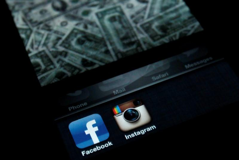 A photo illustration shows the applications Facebook and Instagram on the screen of an iPhone in Zagreb