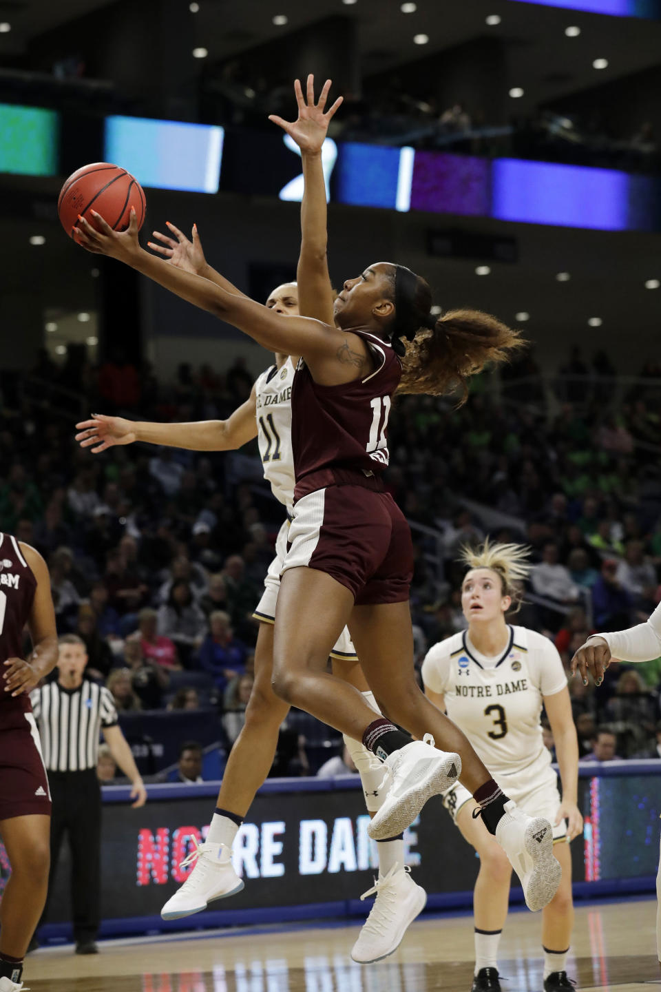 Texas A&M's Kayla Wells goes up for a basket against Notre Dame's Brianna Turner during the first half of a regional semifinal game in the NCAA women's college basketball tournament, Saturday, March 30, 2019, in Chicago. (AP Photo/Nam Y. Huh)