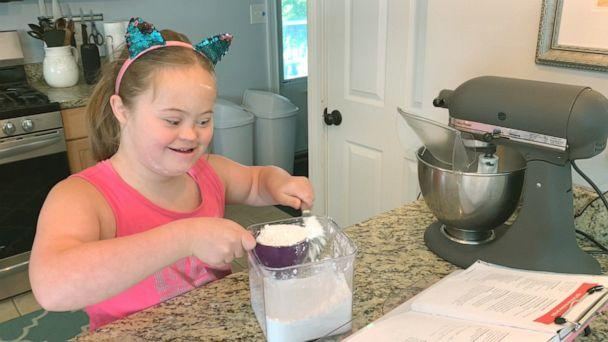 PHOTO: 11-year-old Moriah Winchell of Bridgewater, Mass., is baking with her parents to learn math skills while at home during the pandemic. (ABC News)