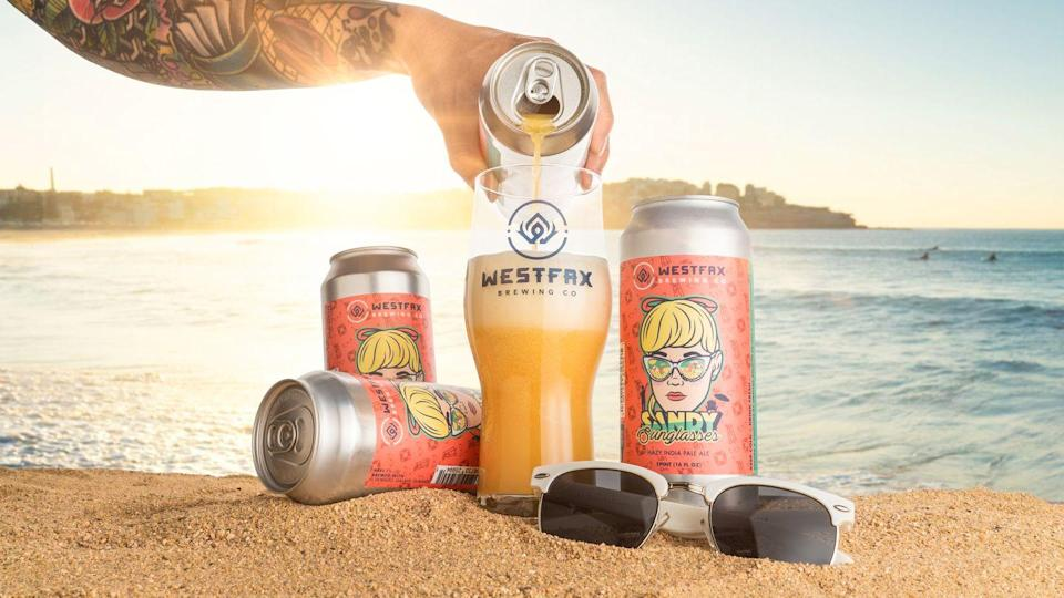 "<p><a href=""https://westfaxbrewingcompany.com/"" rel=""nofollow noopener"" target=""_blank"" data-ylk=""slk:Sandy Sunglasses"" class=""link rapid-noclick-resp"">Sandy Sunglasses</a> is a hazy IPA that screams summertime. The trio of citrus, peach, and white grape flavors is a <a href=""https://www.cosmopolitan.com/party-ideas-entertaining/"" rel=""nofollow noopener"" target=""_blank"" data-ylk=""slk:party"" class=""link rapid-noclick-resp"">party</a> unto itself. Just don't, um, wear the can on your face. (Real sunglasses not included.)</p>"
