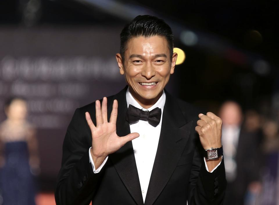 Hong Kong actor Andy Lau poses for photographers on the red carpet at the 50th Golden Horse Film Awards in Taipei November 23, 2013. REUTERS/Patrick Lin (TAIWAN - Tags: ENTERTAINMENT SOCIETY)