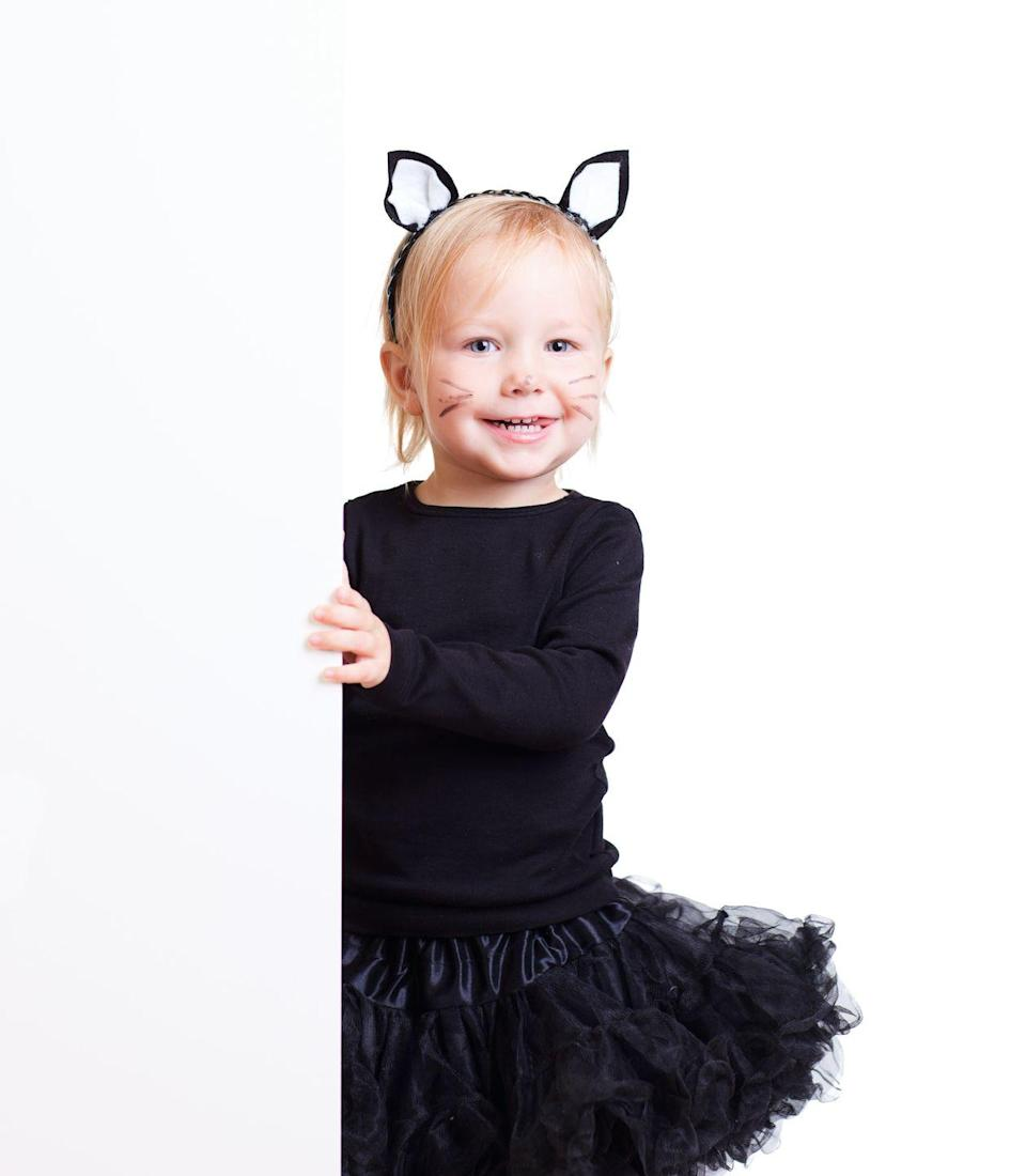 """<p>Similarly, it's so simple to dress your toddler as a cute cat for Halloween. </p><p><strong><a href=""""https://www.countryliving.com/diy-crafts/a22497883/kids-cat-costumes/"""" rel=""""nofollow noopener"""" target=""""_blank"""" data-ylk=""""slk:Get the tutorial"""" class=""""link rapid-noclick-resp"""">Get the tutorial</a>.</strong></p><p><a class=""""link rapid-noclick-resp"""" href=""""https://www.amazon.com/dp/B01M0YPS5U?tag=syn-yahoo-20&ascsubtag=%5Bartid%7C10050.g.4975%5Bsrc%7Cyahoo-us"""" rel=""""nofollow noopener"""" target=""""_blank"""" data-ylk=""""slk:SHOP BLACK TUTU"""">SHOP BLACK TUTU</a></p>"""