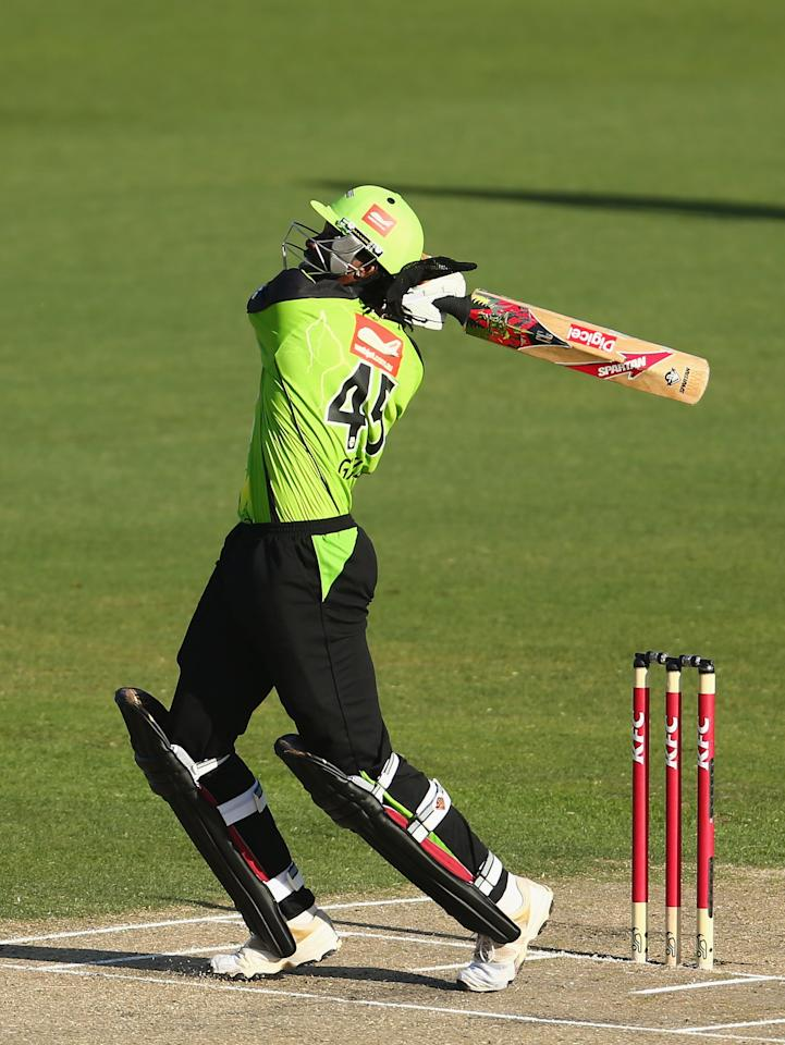 HOBART, AUSTRALIA - DECEMBER 23:  Chris Gayle of the Thunder hits out during the Big Bash League match between the Hobart Hurricanes and the Sydney Thunder at Blundstone Arena on December 23, 2012 in Hobart, Australia.  (Photo by Robert Cianflone/Getty Images)