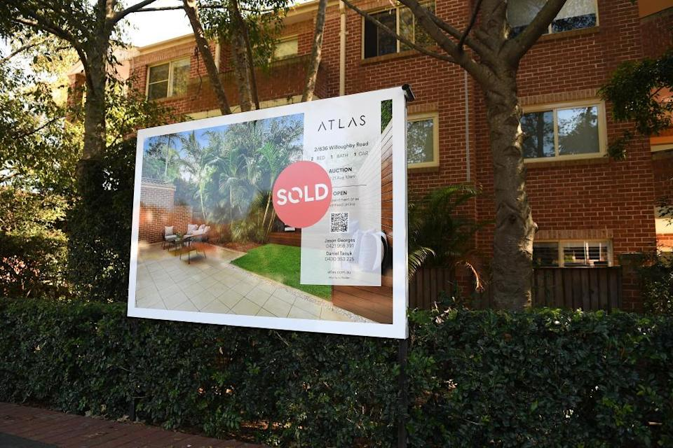 A sold sign in front of a Sydney apartment.
