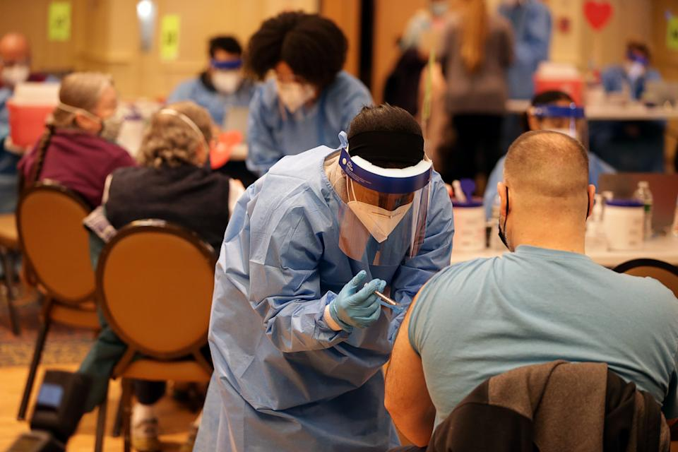 People receiving a COVID-19 vaccine