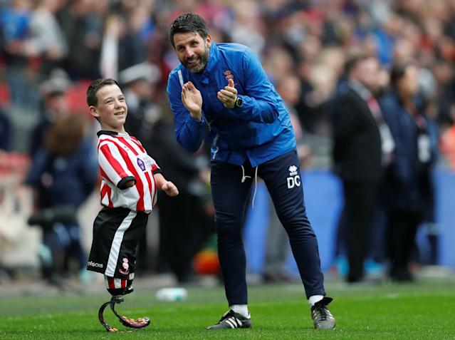 "Soccer Football - Checkatrade Trophy Final - Lincoln City vs Shrewsbury Town - Wembley Stadium, London, Britain - April 8, 2018 Lincoln City manager Danny Cowley (R) with the mascot before the game Action Images/Matthew Childs EDITORIAL USE ONLY. No use with unauthorized audio, video, data, fixture lists, club/league logos or ""live"" services. Online in-match use limited to 75 images, no video emulation. No use in betting, games or single club/league/player publications. Please contact your account representative for further details."