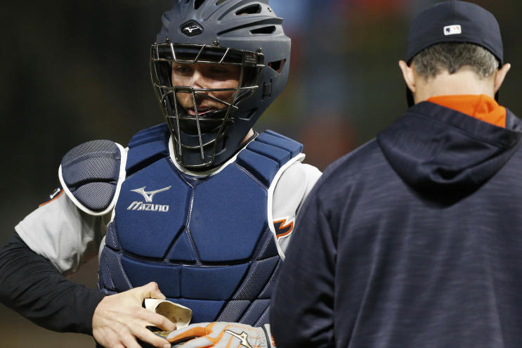 Andrew Romine played all nine position for the Tigers on Saturday, including catcher. (AP)