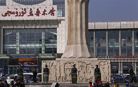 Armed police guard at the entrance of the South Railway Station, where three were killed and 79 wounded in Wednesday's bomb and knife attack, in Urumqi