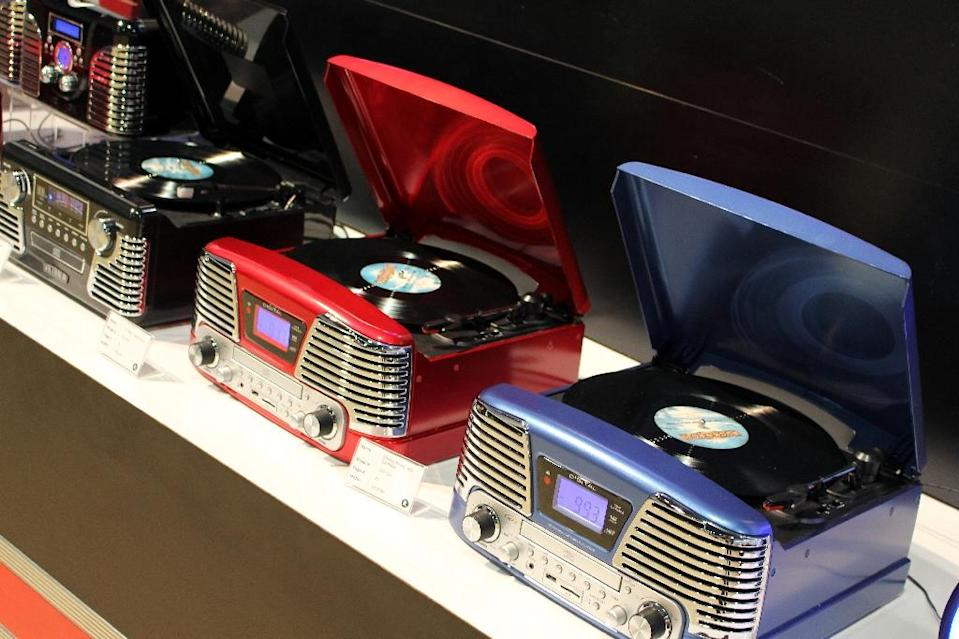 Victrola turntables with vintage designs but modern technology are on display at the Consumer Electronics Show in Las Vegas on January 7, 2016 (AFP Photo/Glenn Chapman)