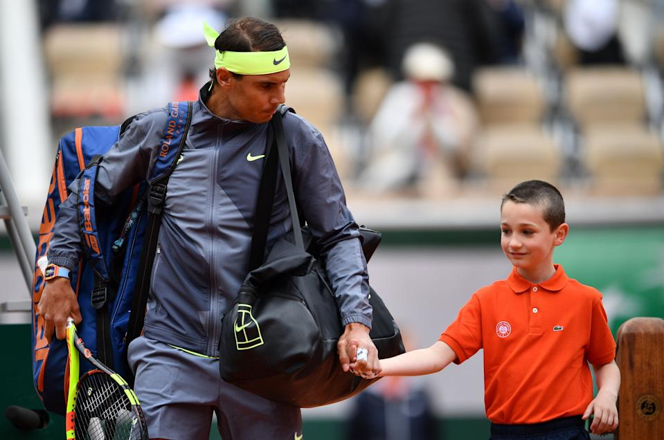 Spain's Rafael Nadal arrives on the tennis court prior to his men's singles semi-final match against Switzerland's Roger Federer on day 13 of The Roland Garros 2019 French Open tennis tournament in Paris on June 7, 2019. (Photo by Martin BUREAU / AFP)        (Photo credit should read MARTIN BUREAU/AFP via Getty Images)