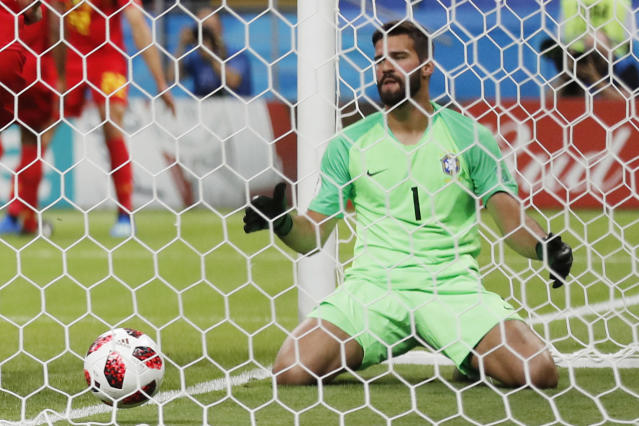 FILE- In this file photo dated Friday, July 6, 2018, Brazil goalkeeper Alisson reacts after Brazil's Fernandinho scored an own goal, during the quarterfinal match between Brazil and Belgium at the 2018 soccer World Cup in the Kazan Arena, in Kazan, Russia. Liverpool announced Thursday July 19, 2018, the signing of Brazil goalkeeper Alisson from Roma, in the latest big-money purchase by the English club.(AP Photo/Frank Augstein, FILE)