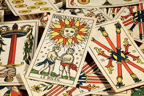 """<span class=""""caption"""">Tarot readers have been cast as swindlers and diviners of the future. The history of the cards suggests they are much more. </span> <span class=""""attribution""""><a class=""""link rapid-noclick-resp"""" href=""""https://www.shutterstock.com/image-photo/set-old-tarot-cards-lying-scattered-181452113"""" rel=""""nofollow noopener"""" target=""""_blank"""" data-ylk=""""slk:Photology1971/Shutterstock"""">Photology1971/Shutterstock</a></span>"""