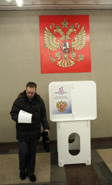 A Russian man walks to cast his ballot at a polling station in Moscow on Sunday, March 4, 2012. Polling stations have opened across Russia's vast expanse for the presidential election widely expected to return Vladimir Putin to the Kremlin. (AP Photo/Misha Japaridze)