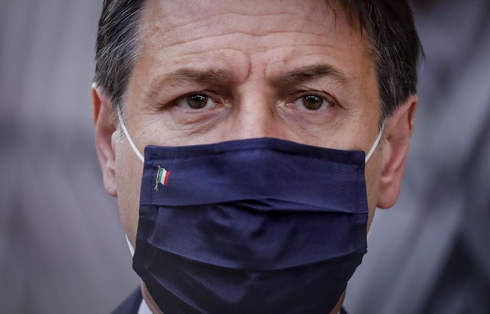 Italian Prime Minister Giuseppe Conte wearing a face mask arrives ahead of a two days European Union (EU) summit at the European Council Building in Brussels, on October 15, 2020. - European leaders meet to re-examine the post-Brexit talks under pressure from English Prime Minister to give ground or see Britain walk away with no trade deal. (Photo by Olivier HOSLET / POOL / AFP) (Photo by OLIVIER HOSLET/POOL/AFP via Getty Images) (Photo: OLIVIER HOSLET via Getty Images)