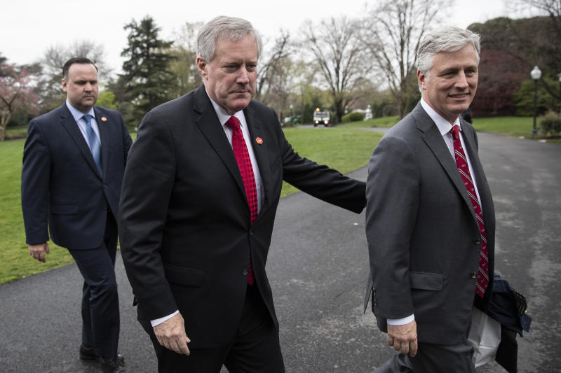 White House Social Media Director Dan Scavino, left, Acting White House Chief of Staff Mark Meadows, and National Security Adviser Robert O'Brien, walk to the West Wing as they return to the White House, Saturday, March 28, 2020, in Washington. President Donald Trump is returning from Norfolk, Va., for the sailing of the USNS Comfort, which is headed to New York. (AP Photo/Alex Brandon)