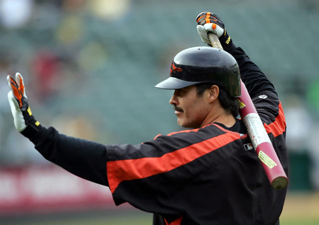 Rafael Palmeiro is 53, but he still wants to play baseball. And the Cleburne Railroaders are giving him a chance. (AP Photo/Marcio Jose Sanchez, File)