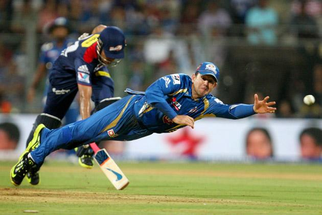 Mumbai Indians captain Ricky Ponting is about take a spectacular catch on the 1st ball of the innings of Unmukt Chand during the match between Mumbai Indians vs Delhi Daredevils Played at Wankhede Stadium in Mumbai, 9 April 2013. (Photo: IANS)