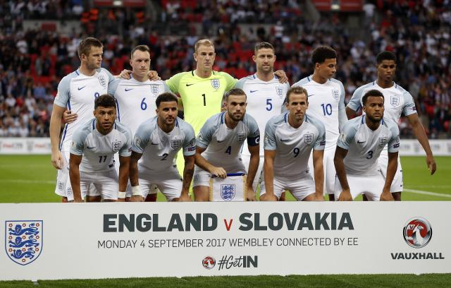 TFILE - In this Monday, Sept. 4, 2017 filer, team England poses prior the World Cup Group F qualifying soccer match between England and Slovakia at Wembley Stadium in London. (AP Photo/Kirsty Wigglesworth, File)