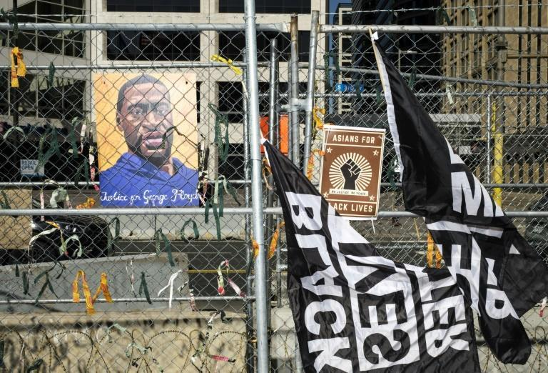 A portrait of George Floyd and banners on security fencing outside the Hennepin County Government Center where former police officer Derek Chauvin is on trial