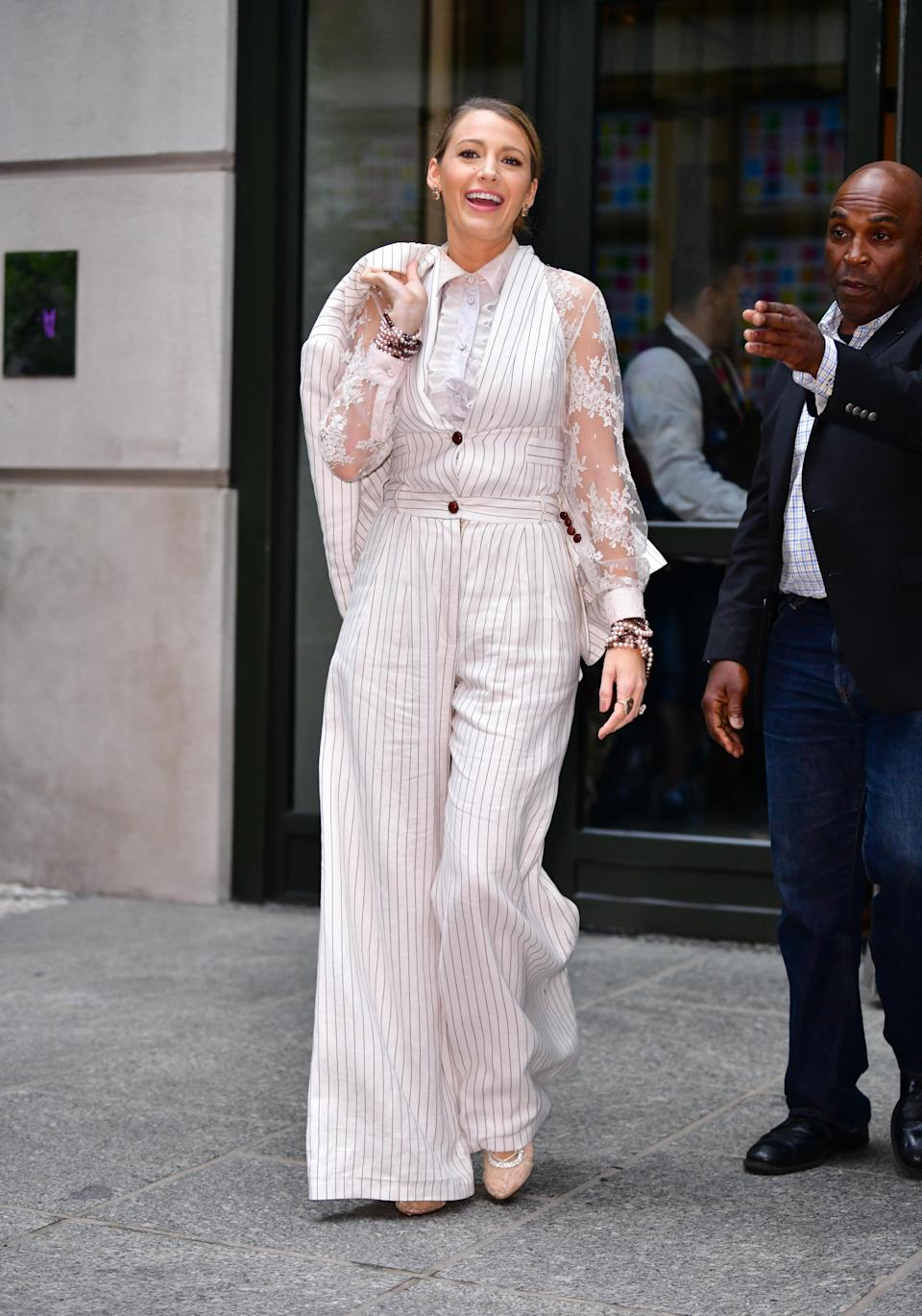 <p>A Zimmerman pinstripe jumpsuit was arguably Blake's top look of the weekend. <em>[Photo: Getty]</em> </p>