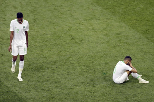 Saudi Arabia's Mohamed Kanno , left, and Mohammed Alburayk, right, after the group A match between Uruguay and Saudi Arabia at the 2018 soccer World Cup in Rostov Arena in Rostov-on-Don, Russia, Wednesday, June 20, 2018. (AP Photo/Themba Hadebe)