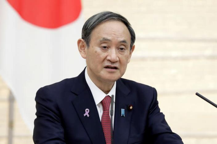 FILE PHOTO: Yoshihide Suga, Japan's prime minister, speaks during a news conference in Tokyo