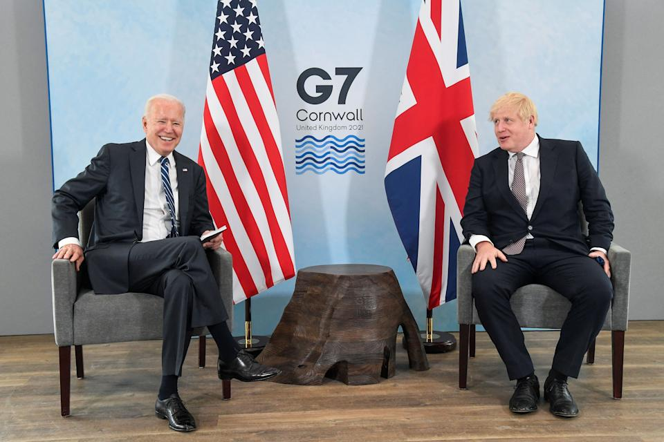 Britain's Prime Minister Boris Johnson (R) and US President Joe Biden pose before a bilateral meeting at Carbis Bay, Cornwall on June 10, 2021, ahead of the three-day G7 summit being held from 11-13 June. - G7 leaders from Canada, France, Germany, Italy, Japan, the UK and the United States meet this weekend for the first time in nearly two years, for the three-day talks in Carbis Bay, Cornwall. - (Photo by TOBY MELVILLE / POOL / AFP) (Photo by TOBY MELVILLE/POOL/AFP via Getty Images) (Photo: TOBY MELVILLE via Getty Images)