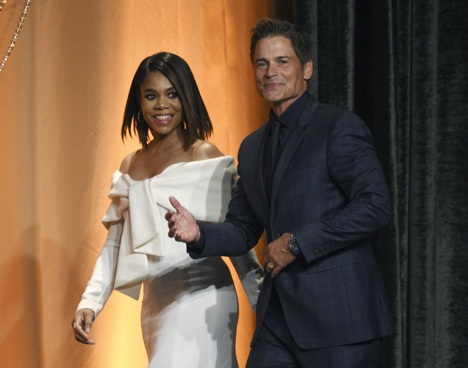Actress Regina Hall, left, and actor Rob Lowe arrive together onstage at the 2019 Hollywood Foreign Press Association's Annual Grants Banquet at the Beverly Wilshire Hotel, Wednesday, July 31, 2019, in Beverly Hills, Calif. (Photo by Chris Pizzello/Invision/AP)