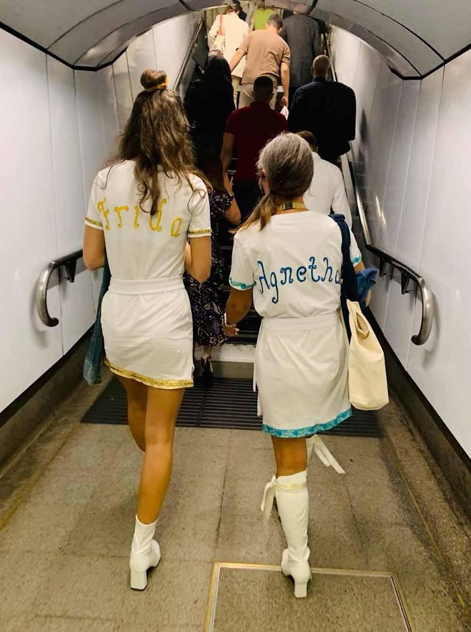 Jane and Chloe walking through the tube to celebrate Mamma Mia reopening in September 2021 (Collect/PA Real Life).