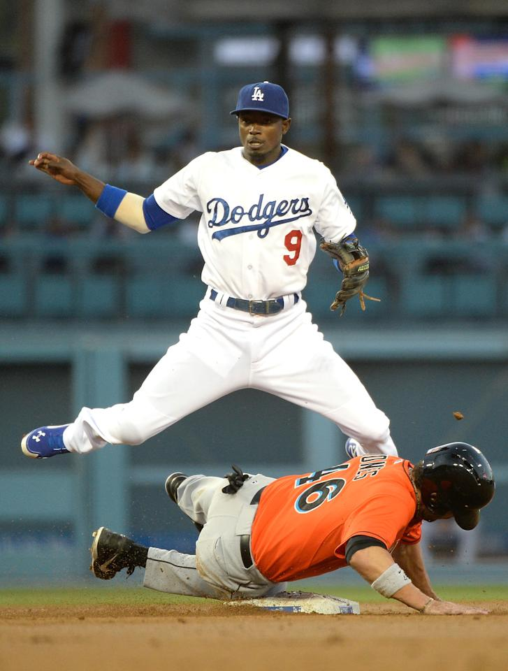 LOS ANGELES, CA - MAY 12: Dee Gordon #9 of the Los Angeles Dodgers reacts to his throw for a double play over Garrett Jones #46 of the Miami Marlins during the second inning at Dodger Stadium on May 12, 2014 in Los Angeles, California. The runner was safe at first. (Photo by Harry How/Getty Images)