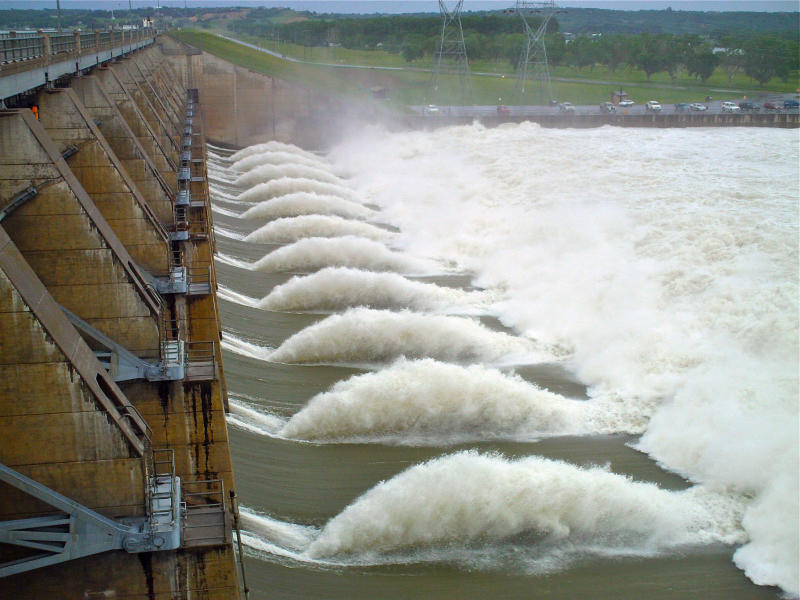 FILE - Floodwaters are released from the Gravins Point hydroelectric dam on the Missouri River, near Yankton, S.D. Renewable energy is growing fast around the world and will be the second biggest source of electricity, after coal, by 2016, according to a five-year outlook published Wednesday, June 26, 2013, by the International Energy Agency. (AP Photo/Robert Ray, File)