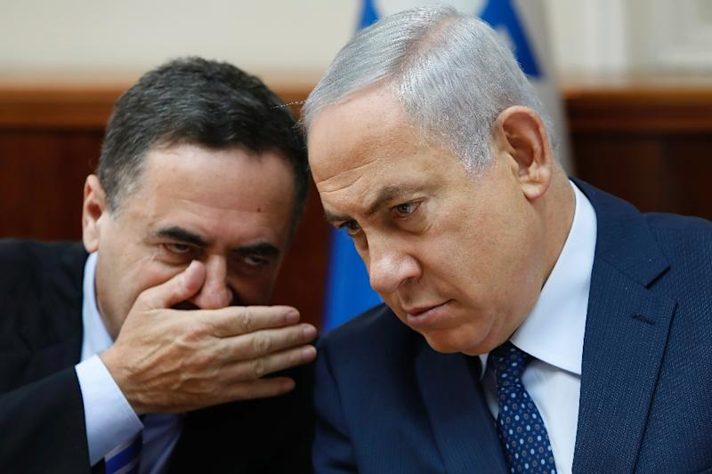 Israeli Intelligence and Transportation Minister Yisrael Katz (L) talks to Prime Minister Benjamin Netanyahu during the weekly cabinet meeting at his Jerusalem office on September 26, 2017