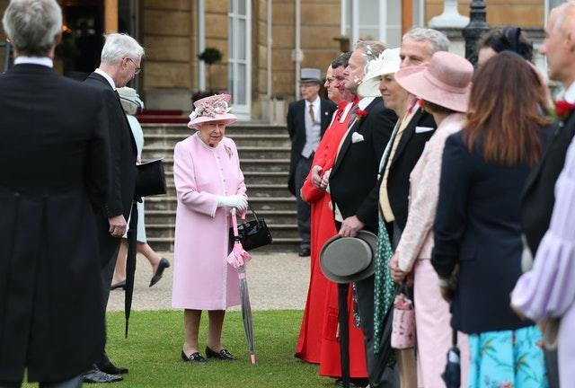 The Queen pictured attending a Buckingham Palace garden party. Yui Mok/PA Wire