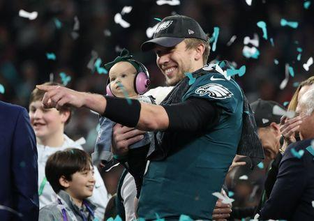 NFL Football - Philadelphia Eagles v New England Patriots - Super Bowl LII - U.S. Bank Stadium, Minneapolis, Minnesota, U.S. - February 4, 2018. Philadelphia Eagles' Nick Foles celebrates winning Super Bowl LII with his daughter. REUTERS/Chris Wattie