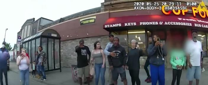 Body camera footage shows a bystander in Minneapolis on May 25, 2020, with Derek Chauvin kneeling on George Floyd's neck.