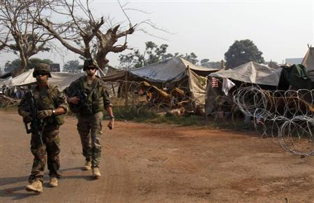 French soldiers walk near a camp for displaced people at M'Poko international airport in Bangui