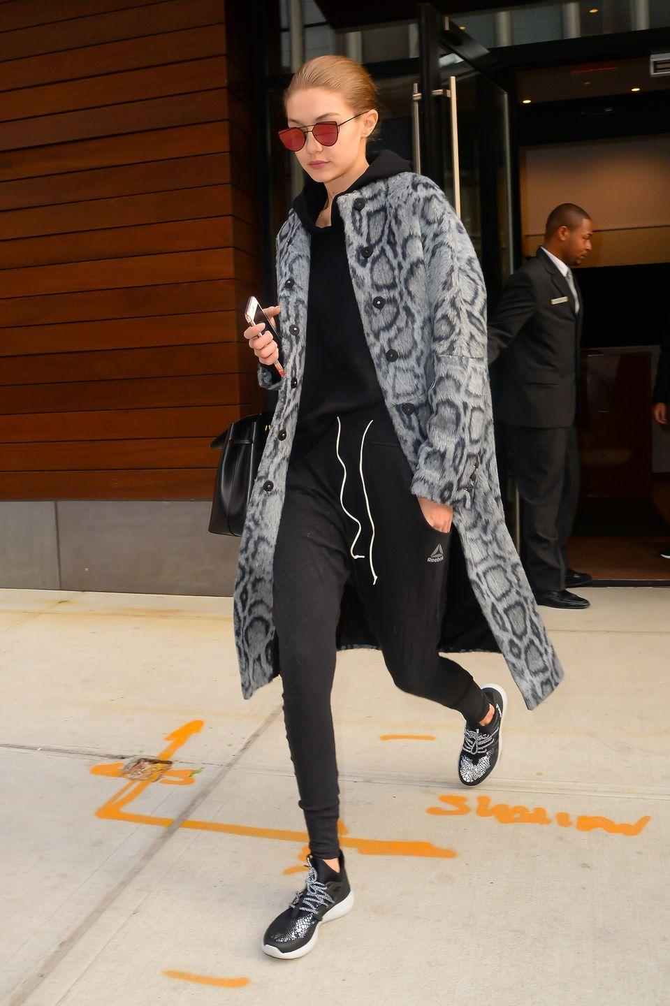 <p>These sweats look runway ready thanks to Gigi's reflective shades and fashion-y coat. </p>