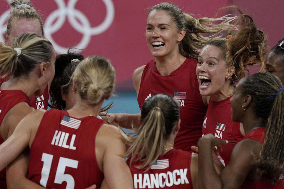 United states players celebrate winning the women's volleyball preliminary round pool B match between United States and Italy at the 2020 Summer Olympics, Monday, Aug. 2, 2021, in Tokyo, Japan. (AP Photo/Frank Augstein)